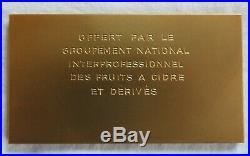 322° plaque en bronze art déco signé Morlon TBE 86grs / 7,5cm sur 4,1cm