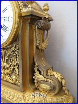 Garniture de cheminée pendule style Louis XVI en bronze doré époque XIX siècle