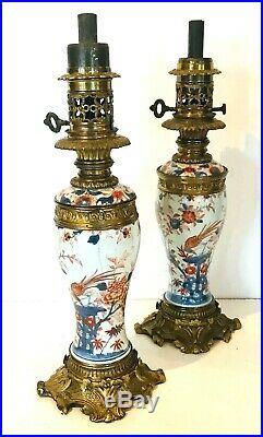 Paire de lampes à pétrole en porcelaine de chine Imari et bronze. XIX siècle